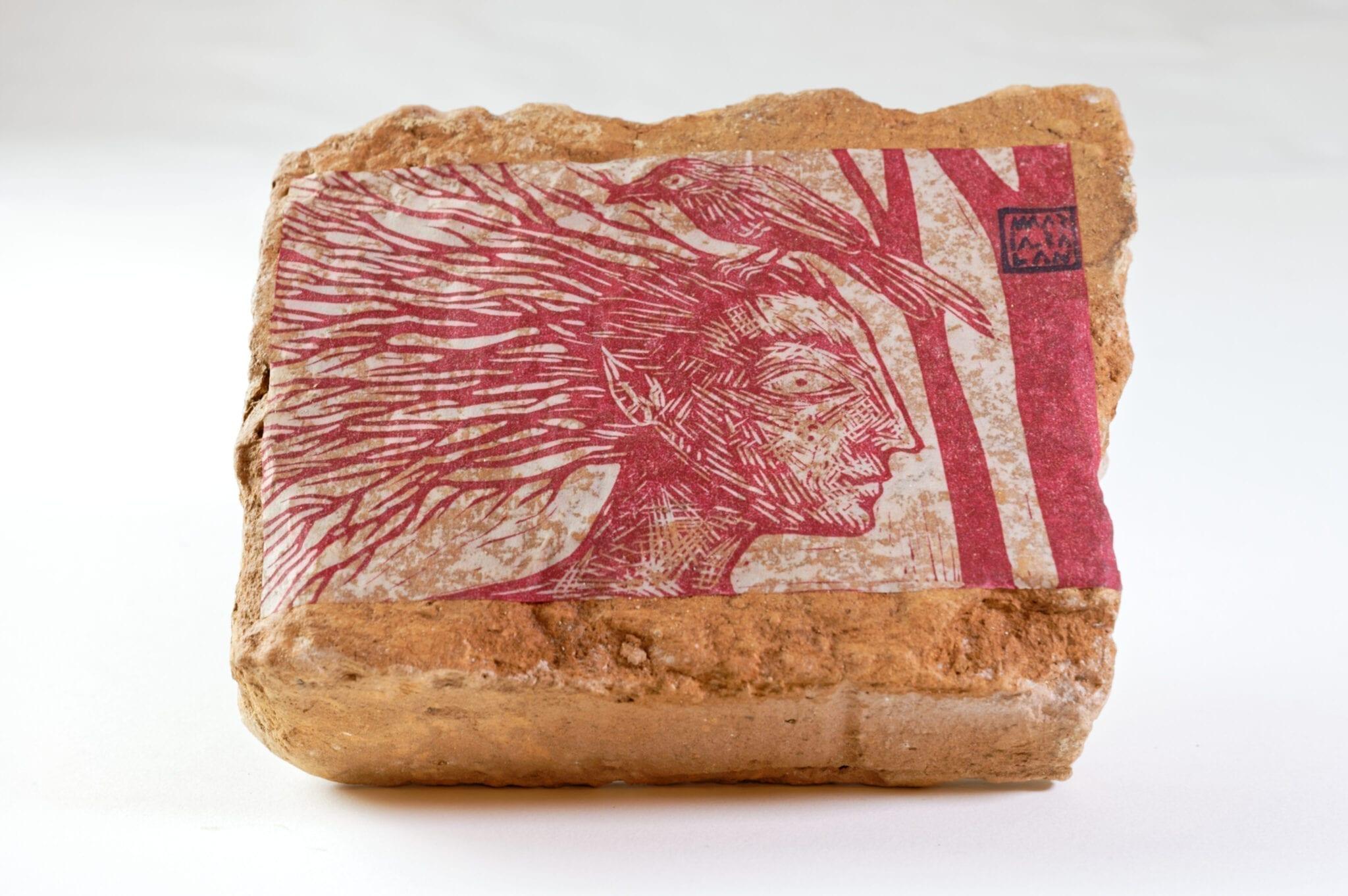 Maria Bălan - Forest Spirit / linocut paste-up on reclaimed brick