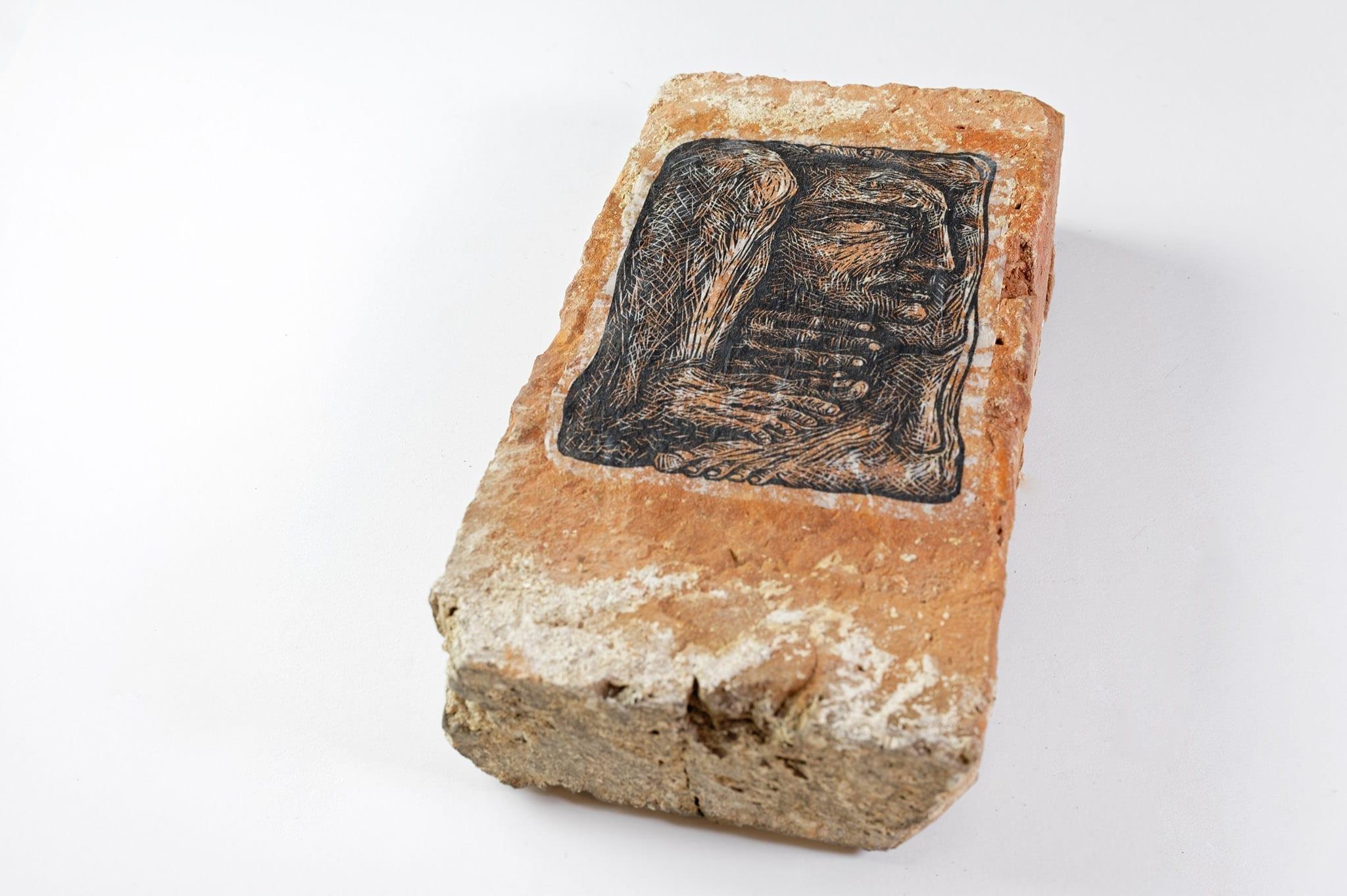 """Humanoprop II"" by Maria Bălan / linocut paste-up on reclaimed brick"