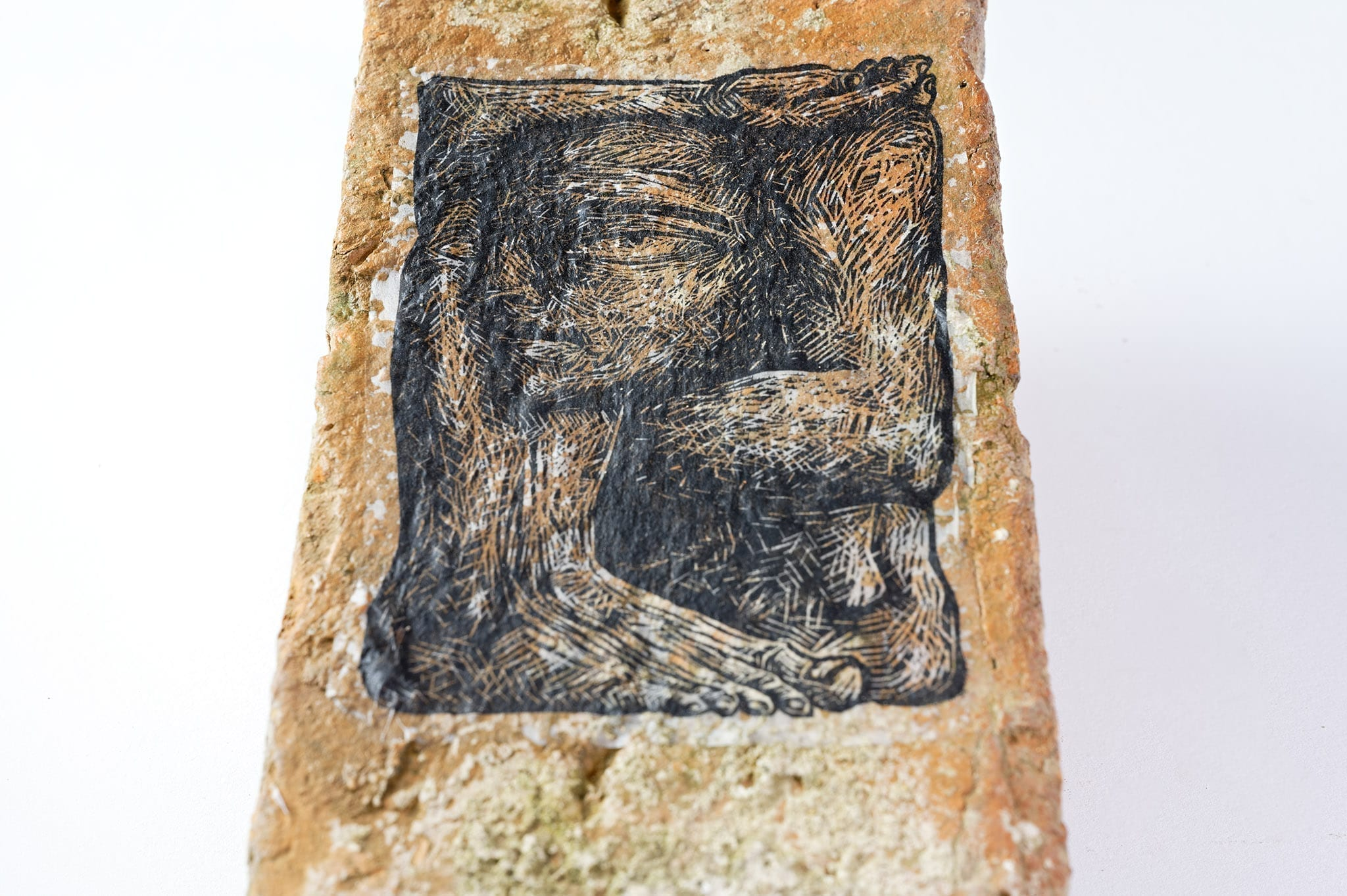 """Humanoprop"" by Maria Bălan / linocut paste-up on reclaimed brick"